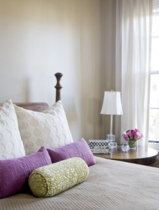 Neutral Walls with Green and Purple Accents